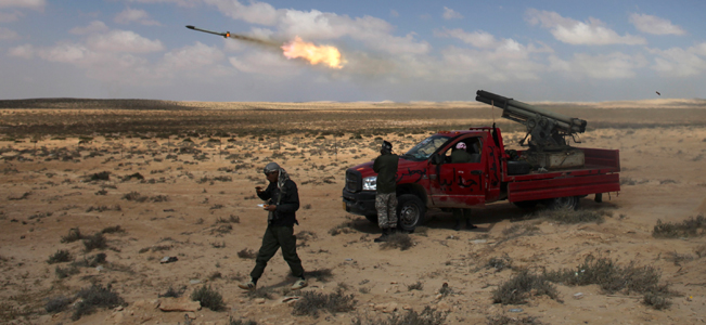 Libyan rebels fire rockets in the desert half way between Ajdabiya and Brega