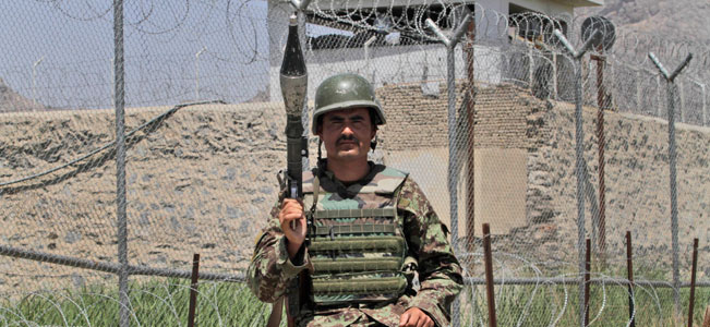 Afghan soldier stands guard outside the main prison in Kandahar, south of Kabul, Afghanistan