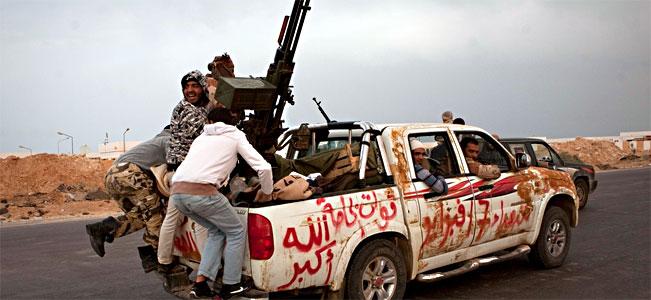 Libya Rebels Flee Gadhafi Assault As World Debates