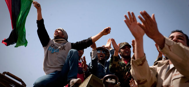 Libyan rebels celebrate on the front line outside of Bin Jawaad, 150 km east of Sirte, central Libya.