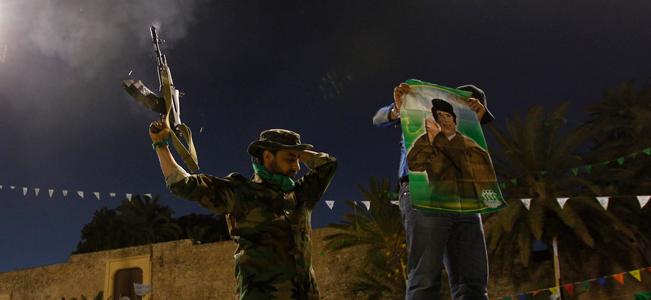 A soldier loyal to Libya's leader Muammar Gaddafi fires shots in the air in Tripol