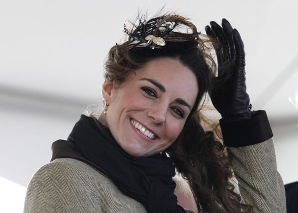 Kate Middleton, the fiancee to Britain's Prince William, smiles during a Naming Ceremony and Service of Dedication for the Royal National Lifeboat Institution's (RLNI) new Atlantic 85 Lifeboat, the 'Hereford Endeavour', at Trearddur Bay Lifeboat Station, in Trearddur Bay, Anglesey in north Wales February 24, 2011. Prince William and bride-to-be Kate Middleton performed their first official engagement as a couple on Thursday, giving them an early taste of the life in the spotlight that awaits them. REUTERS/Phil Noble