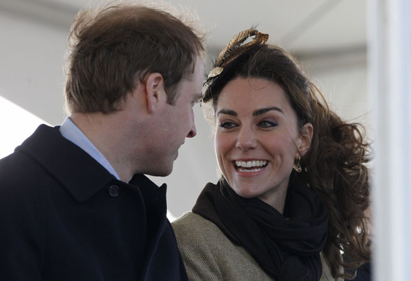 Britain's Prince William and his fiancee Kate Middleton smile during a naming ceremony for the new Royal National Lifeboat Instution's (RNLI) Atlantic 85 lifeboat 'Hereford Endeavour' at Treadur Bay lifeboat station on Anglesey, north Wales, February 24, 2011. REUTERS/Phil Noble