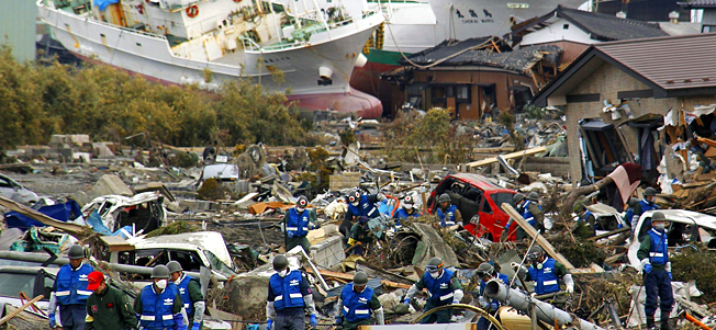 ASoldiers of Japan Self-Defense Force and firefighters search for the victims in the rubbles Monday, March 14, 2011 in Matsushima, Miyagi Prefecture, Japan, three days after northeastern coastal towns were devastated by an earthquake and tsunami