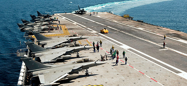 French Navy Rafale and Super etendart jet fighters on the flight deck of Charles de Gaulle aircraft carrier in the Mediterranean sea as part of the Operation Odyssey Dawn