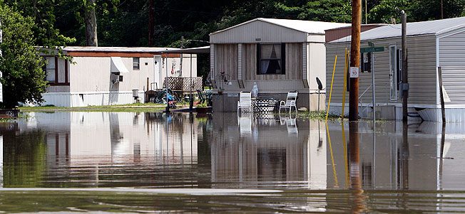 Floodwater covers the road at the Rosewood Estates mobile home park in Memphis, Tenn.