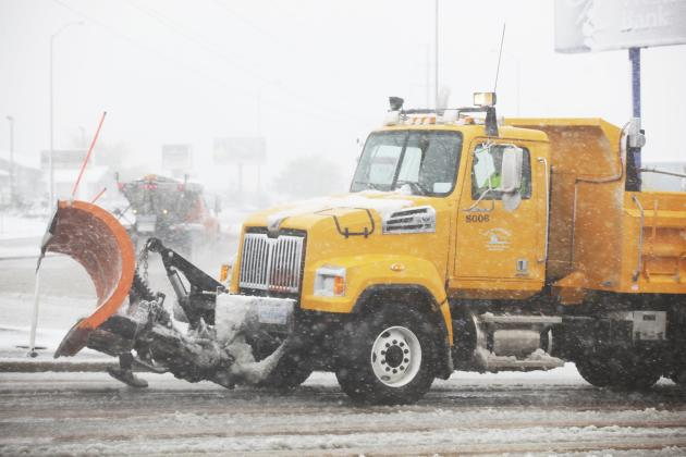 A snowplow is pictured during a snow storm in Rapid City