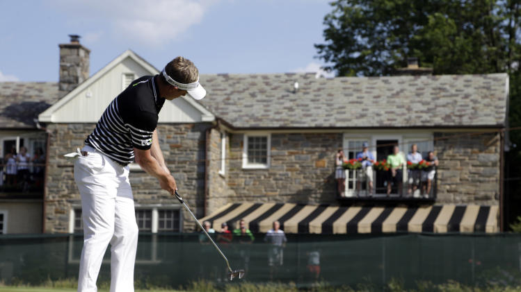 Luke Donald, of England, putts on the seventh green during the third round of the U.S. Open golf tournament at Merion Golf Club, Saturday, June 15, 2013, in Ardmore, Pa. (AP Photo/Morry Gash)