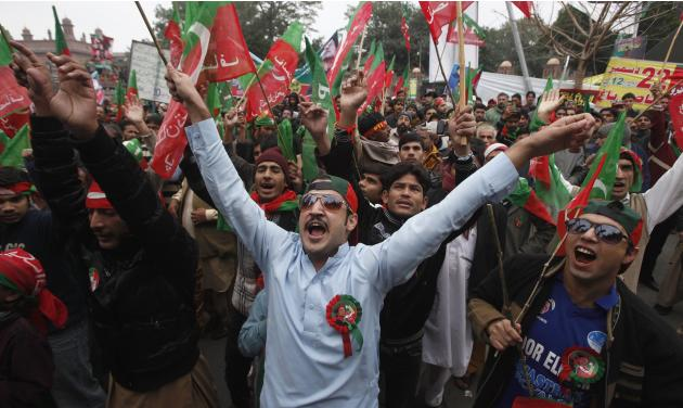 PTI supporters protest against a hike in prices in Lahore