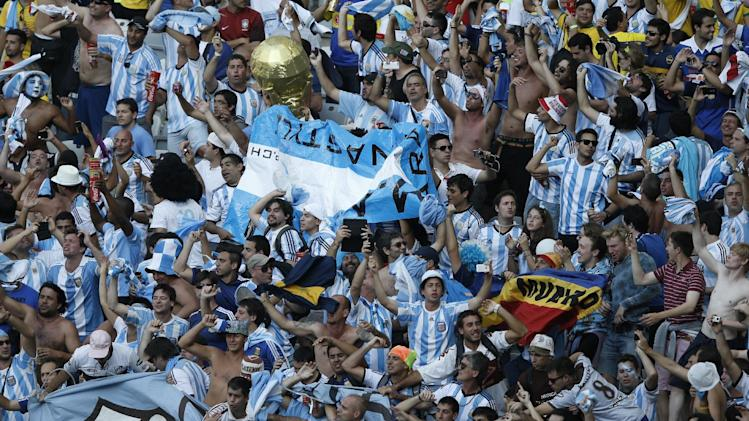 Argentina's fans celebrate after the Group F football match between Argentina and Iran at the Mineirao Stadium in Belo Horizonte during the 2014 FIFA World Cup in Brazil on June 21, 2014