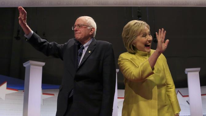 Democratic U.S. presidential candidates Senator Bernie Sanders and former Secretary of State Hillary Clinton arrive on stage ahead of the PBS NewsHour Democratic presidential candidates debate in Milwaukee