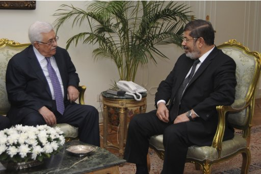 Egypt's President Mohamed Mursi meets with Palestinian President Mahmoud Abbas at the presidential palace in Cairo