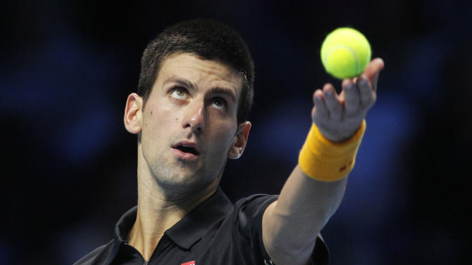 Novak Djokovic of Serbia serves to Andy Murray of Britain during their ATP World Tour Finals singles tennis match at the O2 Arena in London, Wednesday, Nov. 7, 2012. (AP Photo/Sang Tan)