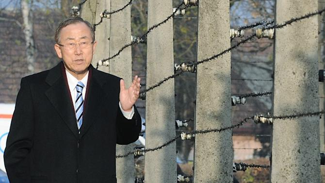 United Nations Secretary General, Ban Ki-moon , walks along a barbed-wire fence as he visits the former German Nazi Death Camp Auschwitz-Birkenau, in Oswiecim, Poland, Monday, Nov. 18, 2013. Ban Ki-moon will attend the U.N. Climate Conference held in Warsaw. on Tuesday (AP Photo/Alik Keplicz)