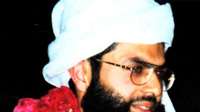 FILE - This undated image released by police in Lahore, Pakistan on Tuesday, Feb. 12, 2002, shows Ahmad Omar Saeed Sheikh. Following his education in Britain, the British-born Sheikh traveled to South Asia, where he joined Islamic militant groups. He was sent to prison for kidnappings Western tourists in India in 1994 but was released to Pakistan five years later in an exchange of prisoners following the hijacking of an Indian airliner to Afghanistan. In 2002 he was convicted of kidnapping and murder in the death of Wall Street Journal reporter Daniel Pearl and sentenced to death. His appeal is still pending in a Pakistani court. (AP Photo/Lahore Police)