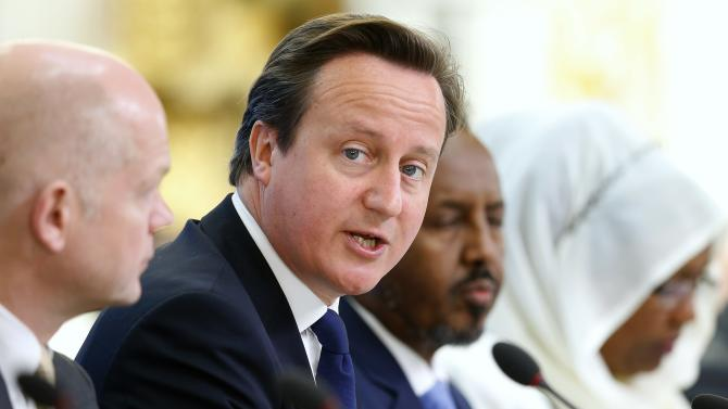 Britain's Prime Minister David Cameron speaks as Britain's Foreign Secretary William Hague, left, and Somali President Hassan Sheikh Mohamud listen at the Somalia conference in London, Tuesday May 7, 2013. British Prime Minister David Cameron is welcoming Somalia's president and a host of international leaders to London for a conference aimed at securing support for the government in Mogadishu after two decades of conflict. (AP Photo/Andrew Winning, Pool)