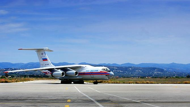 A picture released by the official Syrian Arab News Agency on April 15, 2014 reportedly shows a Russian airplane carrying 15 tons of assorted types of aid at the Bassel al-Assad international airport in Syria's Mediterranean port city of Latakia