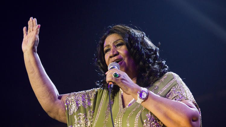 "FILE - In this May 11, 2013 file photo, Aretha Franklin performs during McDonald's Gospelfest 2013 at the Prudential Center in Newark, N.J. Franklin will not be attending a baseball luncheon during which she was to receive an honor for contributions to civil rights. Franklin, 71, has already canceled several concerts recently because of undisclosed health reasons. In a statement issued Monday, Aug. 19, by Major League Baseball, the Grammy-winning singer referred to ongoing ""treatment"" that prevented her from traveling. (Photo by Charles Sykes/Invision/AP, File)"