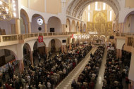 Roman Catholic faithful join Polish politicians for a special Mass for the unity of the European Union and the success of Poland's EU presidency, in Warsaw, Poland, Sunday, Sept. 25, 2011. (AP Photo/Czarek Sokolowski)