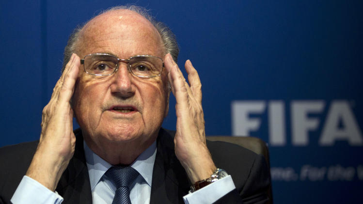 "FILE - In this March 30, 2012 file picture FIFA President Sepp Blatter gestures during a press conference at the FIFA headquarters in Zurich, Switzerland. Soccer is falling under a cloud of suspicion as never before, sullied by a multibillion-dollar web of match-fixing that is staining increasingly larger parts of the world's most popular sport. FIFA President Sepp Blatter has proclaimed ""zero tolerance"" for match-fixing, and FIFA has pledged $27 million to Interpol to fight it. (AP Photo/Anja Niedringhaus,File)"