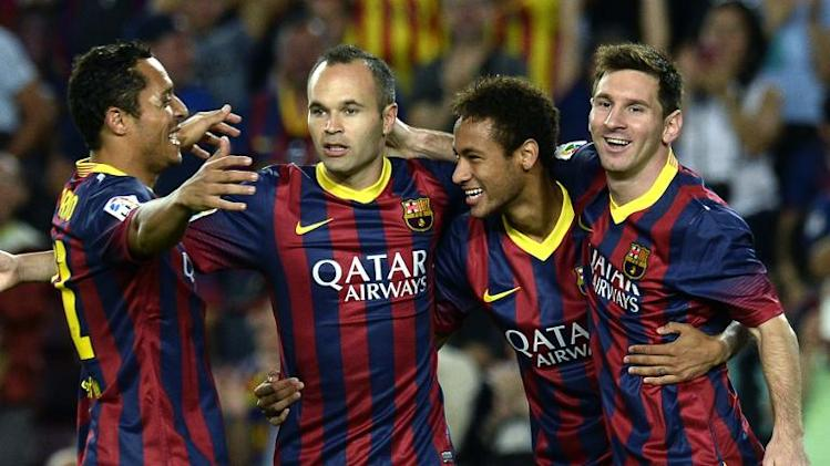 (R-L) Barcelona forwards Lionel Messi and Neymar, midfielder Andres Iniesta and defender Adriano during a game against Real Sociedad at the Camp Nou stadium on September 24, 2013