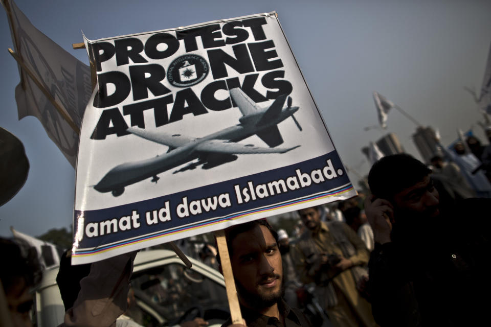 A supporter of the Pakistani religious party Jamaat-u-Dawa holds up a banner during a rally to condemn U.S. drone attacks in Pakistan, in Islamabad, Pakistan, Friday, Nov. 1, 2013. (AP Photo/Muhammed Muheisen)