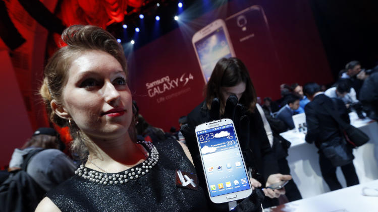 The new Samsung Galaxy S 4 is presented during the Samsung Unpacked event at Radio City Music Hall, Thursday, March 14, 2013 in New York.  (AP Photo/Jason DeCrow)