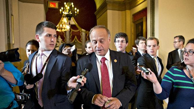 "FILE - In this Oct. 15, 2013 file photo, Rep. Steve King, R-Iowa, walks from House Speaker John Boehner's office with reporters in pursuit on Capitol Hill in Washington. King, a chief Republican foe of immigration legislation says it would be a ""colossal mistake"" for the House to consider any measure this year and shift attention from President Barack Obama's health care law. (AP Photo/J. Scott Applewhite, File)"