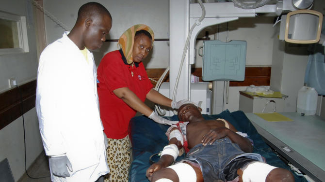 A man who was injured by an explosion at a bar in the Mishomoroni district of Mombasa, which police at the scene said was a grenade attack, is treated at the Coast General Hospital in Mombasa, Kenya late Sunday, June 24, 2012. The explosion comes after the U.S. Embassy in Kenya on Friday warned of an imminent threat of a terrorist attack in Mombasa and said all U.S. government personnel had to leave the city. (AP Photo)