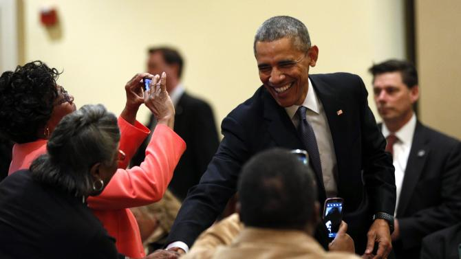 Obama shakes hands during a stop at the Brookland Baptist Church conference center in West Columbia