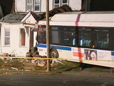 Bus plows into NY home, kills boy