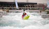 A man kayaks at the Lee Valley White Water Centre in Hertfordshire, England, the venue for the canoe slalom event during the London 2012 Olympic games, in January. The &quot;Made in Portugal&quot; label will dominate the waters at the London Olympics, with the country&#39;s kayak-canoe industry prospering despite a floundering economy