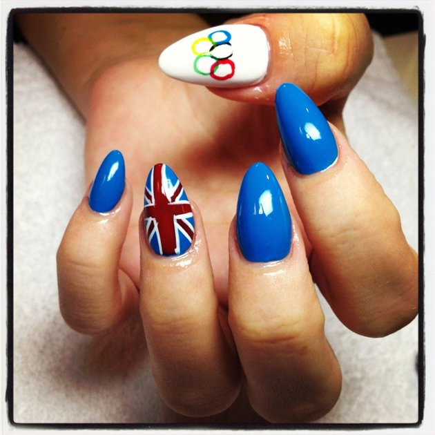 Celebrity photos: Lily Allen also got behind Team GB by having her nails painted in their honour. We especially love the nail with the Olympics rings on – too cute!