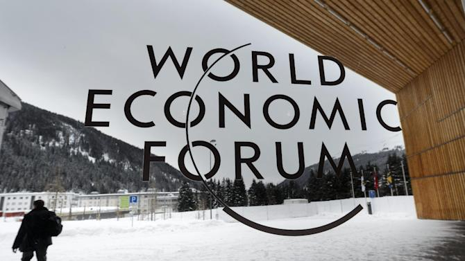 """A man walks outside the main entrance of the Congress Center, on the eve of the opening of the 43rd Annual Meeting of the World Economic Forum, WEF, in Davos, Switzerland, Tuesday, Jan. 22, 2013. The overarching theme of the meeting, which will take place from 23 to 27 January, is """"Resilient Dynamism"""". (AP Photo/Keystone, Laurent Gillieron)"""