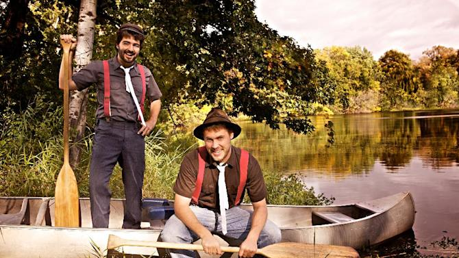 In this 2011 photo provided courtesy of Alex Johnson, the Okee Dokee Brothers, Joe Mailander, right, and Justin Lansing pose for a photo along the Mississippi River. The Minneapolis duo has been nominated for a Grammy Award for best children's album. (AP Photo/Courtesy of Alex Johnson)