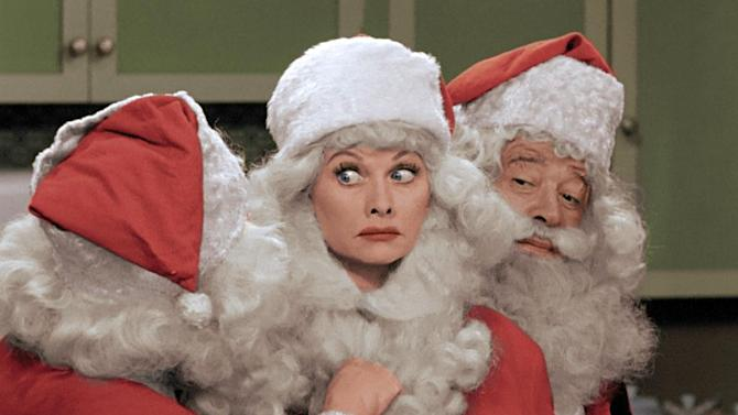 """This image released by CBS shows Lucille Ball, center, dressed as Santa Claus in a colorized """"I Love Lucy Christmas Special"""" airing on Friday, Dec. 20, on CBS. (AP Photo/CBS)"""