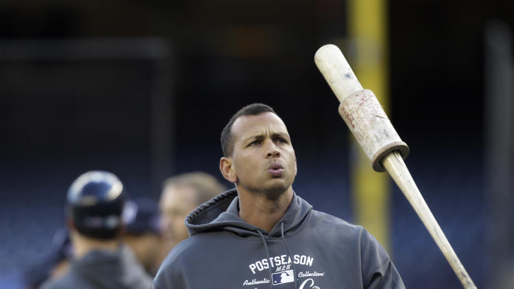 New York Yankees Alex Rodriguez tosses his bat during batting practice before Game 5 of the Yankees American League Division Series baseball game against the Baltimore Orioles at Yankee Stadium in New York, Friday, Oct. 12, 2012.  Rodriguez, who is 2 for 16 with nine strikeouts in the series, was benched for Game 5. (AP Photo/Kathy Willens)
