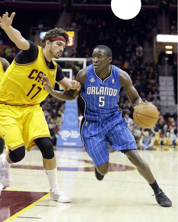 Orlando Magic's Victor Oladipo (5) drives past Cleveland Cavaliers' Anderson Varejao (17), from Brazil, during the fourth quarter of an NBA basketball game Thursday, Jan. 2, 2014, in Cleveland