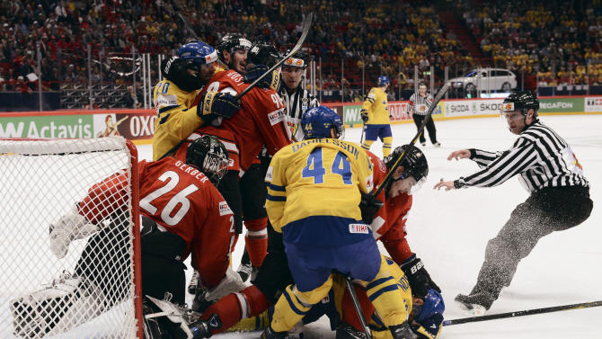 A fight breaks out in the last second of the first period during the 2013 Ice Hockey IIHF World Championships gold medal match between Switzerland and Sweden, at the Ericsson Globe Arena in Stockholm, Sweden, Sunday, May 19, 2013. (AP Photo /Fredrik Sandberg / Scanpix)  SWEDEN OUT