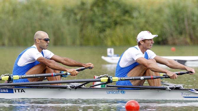 Lorenzo Bertini, left, and Elia Luini, right, of Italy compete in the final of the Lightweight Men's Double Sculls during the rowing World Cup on lake Rotsee in Lucerne, Switzerland, Sunday, July 10,  2011. (AP Photo/Keystone, Urs Flueeler)   GERMANY OUT AUSTRIA OUT