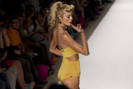 A model wears swimwear from the Nicolita collection at the Mercedes Benz Fashion Week Swim 2013 show on Miami Beach, Fla., Friday, July 20, 2012. (AP Photo/J Pat Carter)