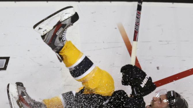 Toronto Maple Leafs center Nazem Kadri, bottom, drops Boston Bruins defenseman Johnny Boychuk, top, to the ice during the second period in Game 7 of their NHL hockey Stanley Cup playoff series in Boston, Monday, May 13, 2013. (AP Photo/Charles Krupa)