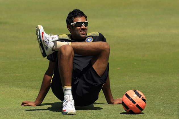India's cricket player Ravichandran Ashwin sits on the ground during their training session at Wanderers stadium in Johannesburg, South Africa, Wednesday, Dec. 4, 2013. India will play their One D