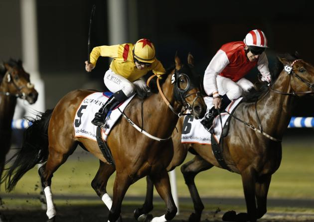 "Mullen, riding Reynaldothewizard of the U.S., races towards the finish line during the sixth race ""Dubai Golden Shaheen"" of the Dubai World Cup at the Meydan Racecourse in Dubai"