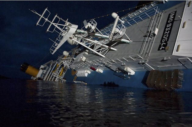 In this undated photo released by the Italian Navy Tuesday, Jan. 24, 2012,  the Costa Concordia cruise ship grounded off the Tuscan island of Giglio, Italy, is seen at night.  A large platform carryin