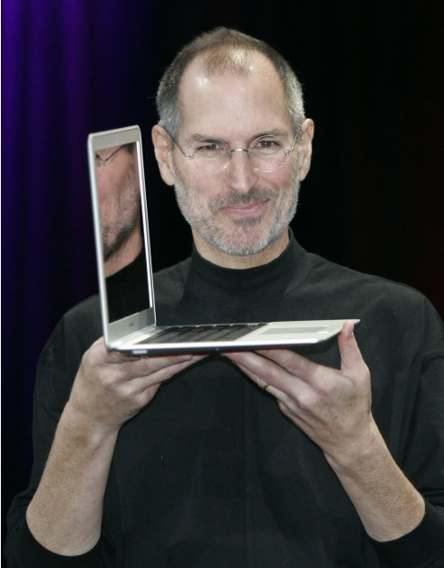 FILE - In this Jan. 15, 2008 file photo, Apple CEO Steve Jobs holds up the MacBook Air after his keynote at the MacWorld Conference in San Francisco. Apple Inc. on Wednesday, Aug. 24, 2011 said Jobs i