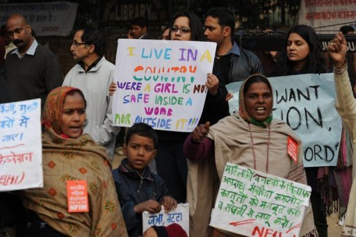 <p>Indian protesters hold placards during a rally in New Delhi on December 31,2012 over the gang-rape of a young woman. The gang of men tried to run their victim over after the fatal attack, reports said, citing a grisly police account of the incident.</p>