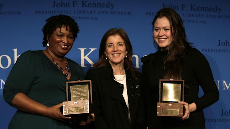 Caroline Kennedy, daughter of the late President John F. Kennedy, poses with Stacey Abrams, left, and Veronika Scott, right,after presenting the annual Frontier Award at the John F.Kennedy Library in Boston, Monday, Nov. 19, 2012.  Abrams, minority leader of Georgia's House of Representatives, is the first woman to lead either party in Georgia's General Assembly.  Scott, was honored for her project in Detroit that provides jobs for female shelter residents, who make coats for the homeless that transform into sleeping bags. (AP Photo/Charles Krupa)