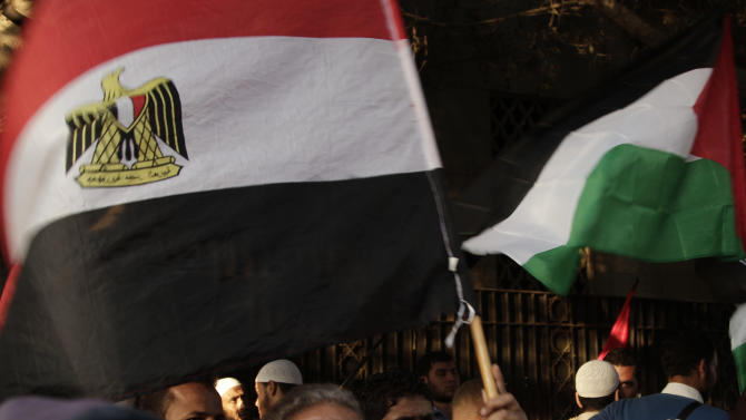 "Protesters wave the Egyptian and Palestinian flags during a protest in solidarity with Gaza after Israel launched its operation on Wednesday with the assassination of Hamas' top military commander in front of the Arab League building Cairo, Egypt, Thursday, Nov. 15, 2012. Egypt asked the United States to push Israel to stop its offensive against Hamas militants in the Gaza Strip, warning that the violence could ""escalate out of control,"" the Foreign Ministry said Thursday. (AP Photo/Nariman El-Mofty)"
