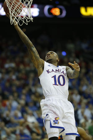 Kansas guard Tharpe to transfer for final season